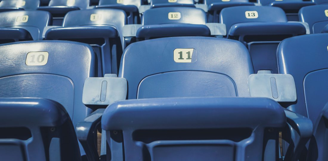 empty seats at a baseball stadium due to covid-19