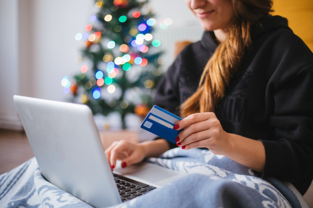 female holiday shopping online with a credit card