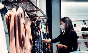 female shopping in store while wearing a face mask